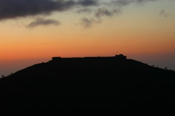 Sunset, silhouetting High Knoll Fort  (Click to see the full-sized image, opens in a new window or tab)